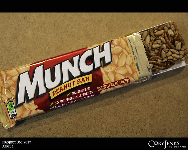 Project 365: April 1 - Munch<br /> <br /> Been a while since I had a Munch Peanut Bar and was surprised when I opened it and they had changed from actual peanuts to sunflower seeds and mealworms. Not too bad, super crunchy and slightly sweet.