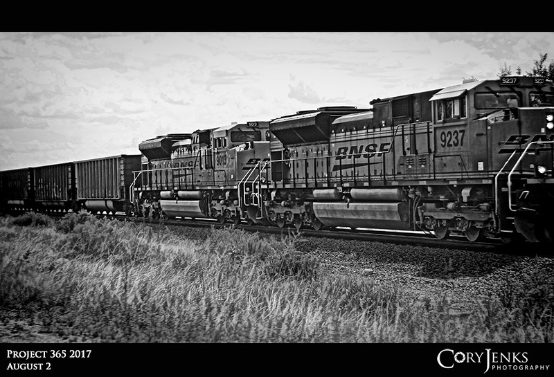 Project 365: August 2 - 9013 and 9237<br /> <br /> A couple of Burlington Northern and Santa Fe locomotives pulling cars along the front range.