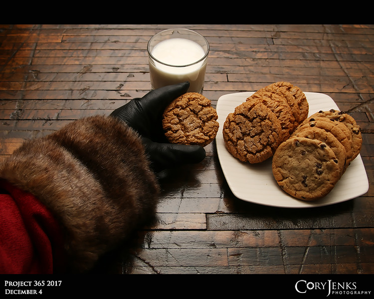 Project 365: December 4 - Santa's Helping Hand #4<br /> <br /> Santa helps himself to a ginger snap cookie. Santa is always willing to support National Cookie Day.