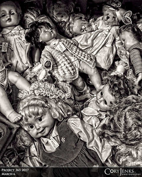 Project 365: March 6 - Creepy or Sad<br /> <br /> Doing a little antique shopping yesterday, I encountered a pile of dolls. Not sure if this is creepy or sad. Sad, because dolls should be played with and bring joy to a child....... wait, never mind, it's definitely creepy.
