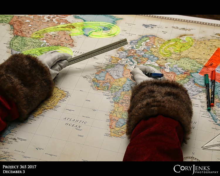 Project 365: December 3 - Santa's Helping Hand #3.<br /> <br /> Santa helps plan the 2017 trip around the world.  Being as meticulous as he is, Santa spends the entire year preparing for this single event. He compiles his demographic data on believers and non-believers  along with his list of naughty and nice children that is presumably hundreds of millions of entries long. He then thoroughly checks the list not once, but twice. The route year after year is never the same.