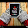 2018 Project 365: December 23 - Santa's Helping Hands #23<br /> <br /> Santa helps process this year's naughty and nice list before the big trip using his new app,