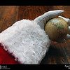 2018 Project 365: December 6 - Santa's Helping Hand #6<br /> <br /> Santa helps calibrate his pocket globe that he uses to navigate his trip around the world in one night.