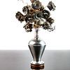 2018 Project 365: April 19 - Neighborly <br /> <br /> A next door neighbor handcrafted this vase of flowers as a small 'thank you'. The roses are metal shavings and copper wire and the vase is hand-lathed aluminium. Flower vase is set on three dimes to show scale.