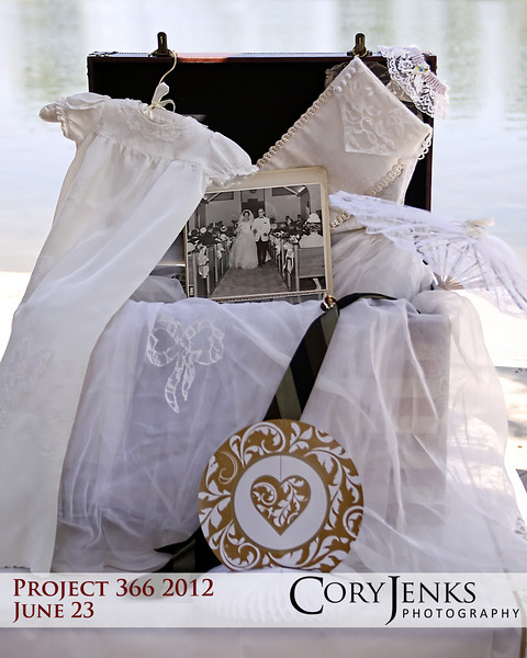 Project 366: June 23 - Repurposed. Honored to photograph my second 50th Wedding Anniversary celebration, and this is the wedding dress worn by the bride and later her sister. Over the years portions of the dress have been repurposed into a christening gown and a Christmas stocking.