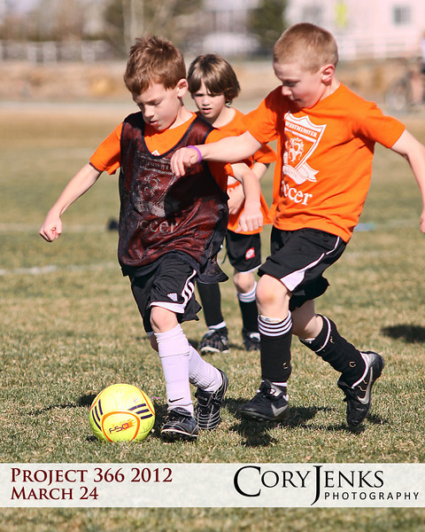 Project 366: March 24 - Battling. The battles for the ball even happen at U7. Could not ask for a better day for spring soccer.