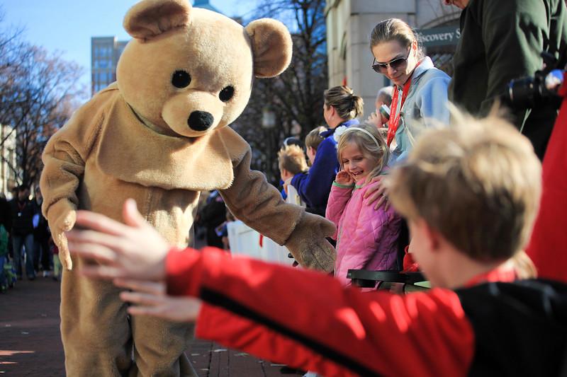 Teddy bear high-fives at the Reston Holiday Parade