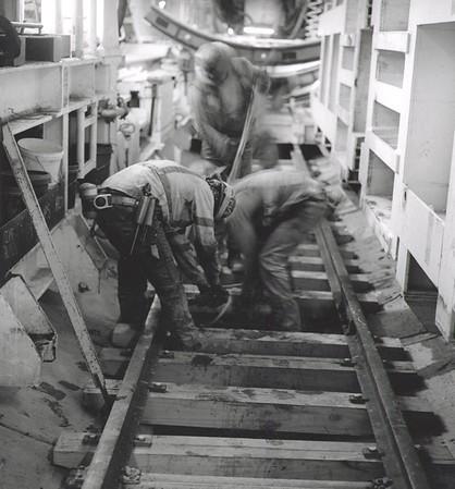 Miners Installling Rail Track Inside TBM (Photo credit: Ken Karagozian)