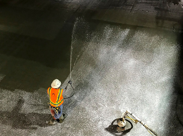 Applying the cure compound for the slab inside Wilshire/Western TBM retrieval shaft.