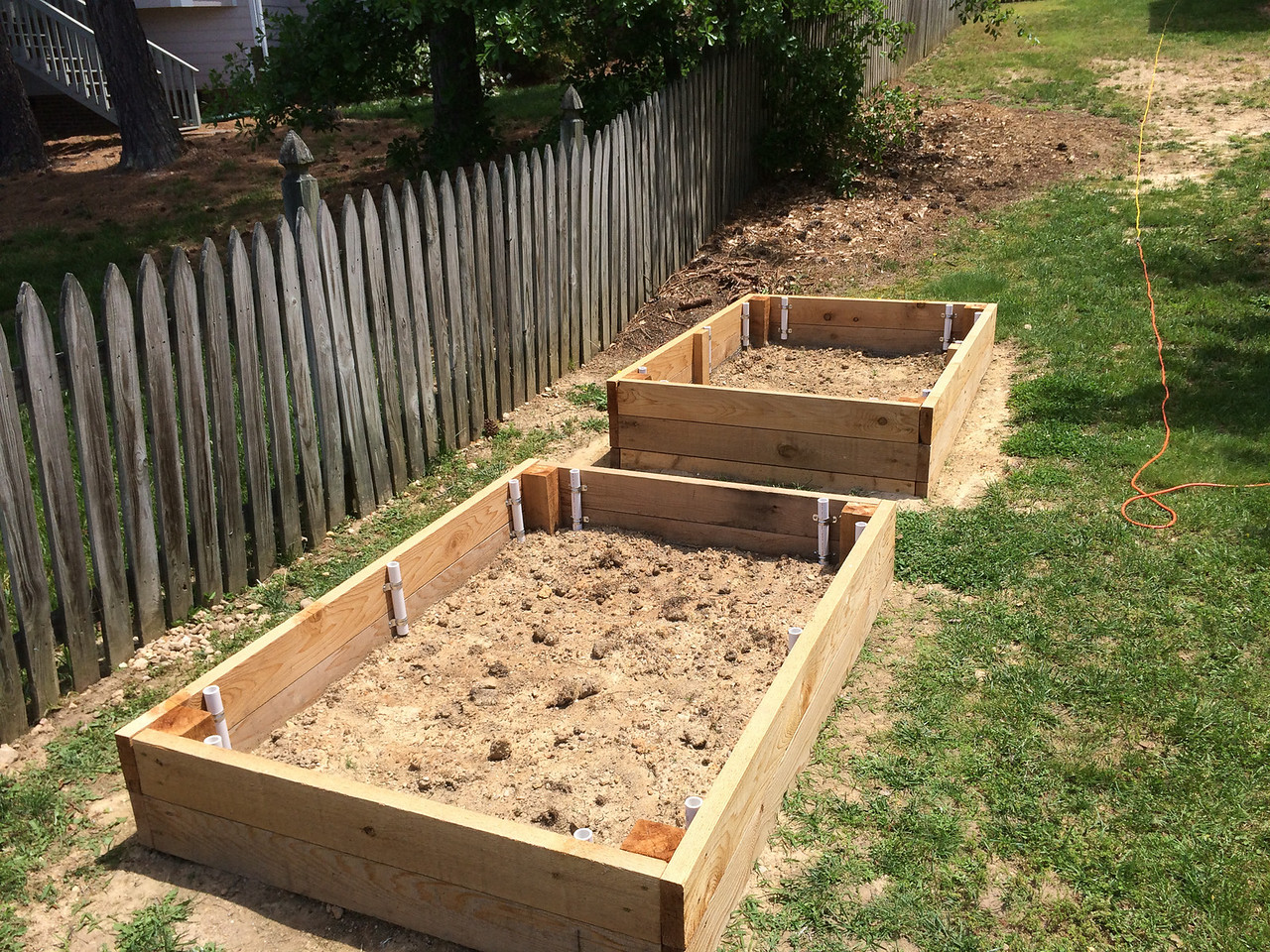 After finishing the PVC sections in both beds. Now they're ready for filling with garden soil. It has been weeks getting to this point. Projects move slowly when there's a toddler in the house. Not knowing what you're doing  doesn't help, but I'm blaming the kid. ;)