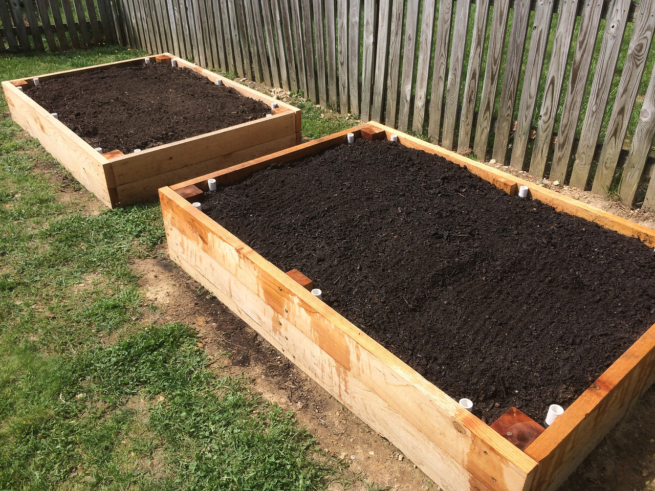 Finally, the beds are full of the new garden soil. It took almost all of those 1.5 cubic yards to get these topped off. I'm assuming they will settle a little bit over the next few weeks as they get rained on.<br /> <br /> Next step is to plant. For now I'm going to take some ibuprofen and lay on the couch.