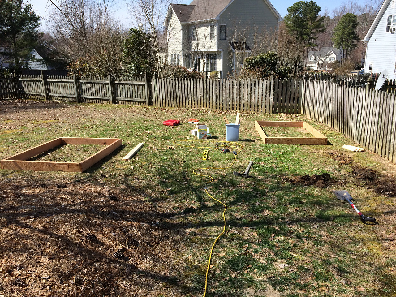 On the first day I assembled all my tools, naively thinking I'd get the whole project done in a single day... I was not being smart.<br /> <br /> The beds would be two boards tall, but I set up one level each as mock-ups so I could settle on their positions and mark out the ground.