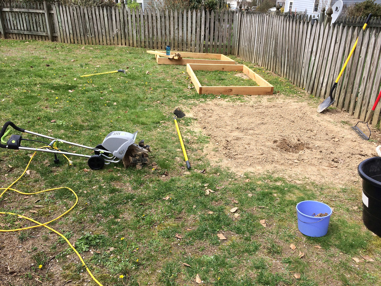 We bought a small electric tiller, the Earthwise TC70001. Since I've already dug and turned the dirt the tiller makes short work of it. It would have been a much slower process if I hadn't used the shovel first. Or at least that's what I tell myself.