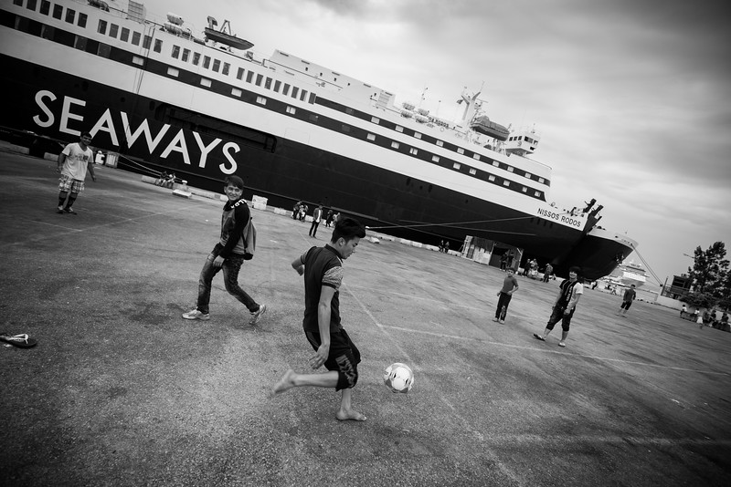 After their arrival on the Greek islands, all the refugees had to go through the port of Athens, Piraeus. They now live there permanently, living among the huge boats they used to come with, reminding them constantly of their stillness. <br /> <br /> Port of Piraeus, Athens, Greece. May 2016