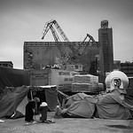 The improvised camps and makeshift tents that sprawled among the ports have since then been moved out after the whole place was acquired by a Chinese conglomerate.  Port of Piraeus, Athens, ...