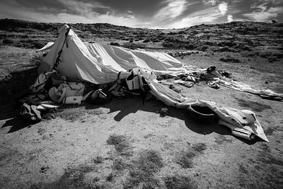 The tents used by the NGOs to help refugees landing on the island are now empty reminders of the intense activities and events that took place on these once pristine beaches.  Lesvos Island, Greece. June 2016.