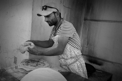 Life that was supposed to be transitory in the camps is now a permanent state and routine settles in. Bakers are setting up shops in the camps and initiatives are spreading.  Eko Petrol station Camp, Polykastro area, Greece. May 2016.