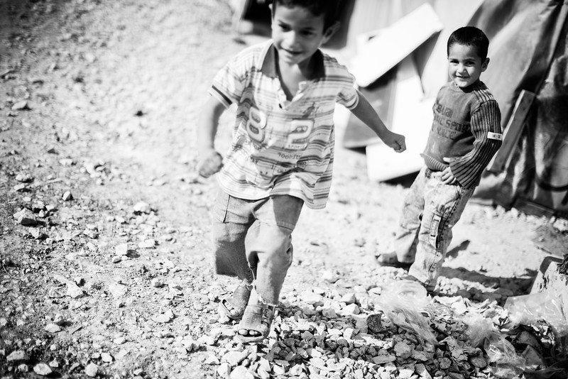 Children run and play in the camps. Winter gets really cold in these camps that sometimes receive snow. Last year was particularly unusual in the important amount of snow received. As people are not prepared or dressed adequately, the death toll was alarmingly high. Bekaa Valley, Lebanon.