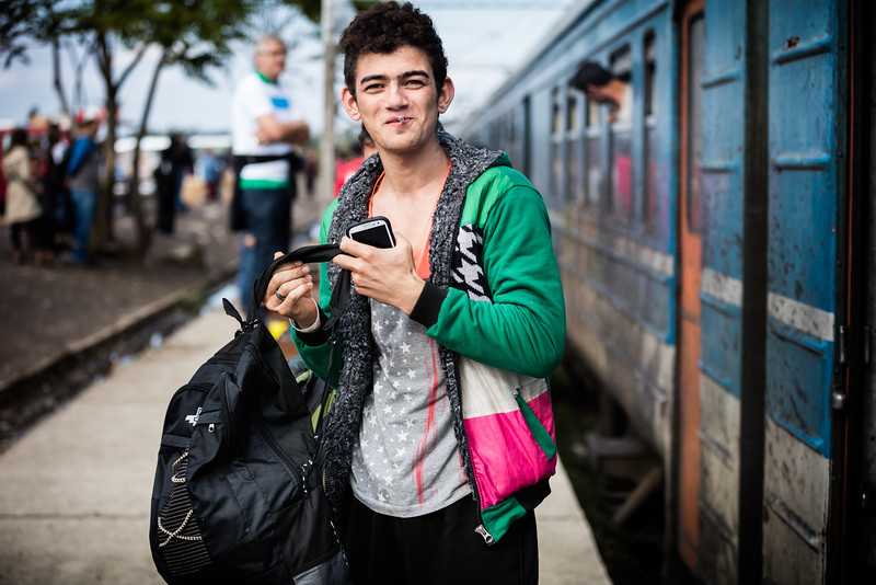 Happy to be on his way, this young man gets off the train in the North of Macedonia, FYROM. Tabanovce, Macedonia (FYROM).