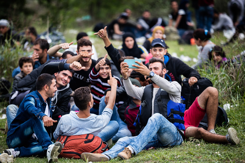 Taking selfies is a favorite for the refugees. They document their journey and are happy to walk towards a better life. These pictures will be the memories of their exile. As a photographer, I've been invited in more than a few selfies! Gevgelija, Macedonia (FYROM).
