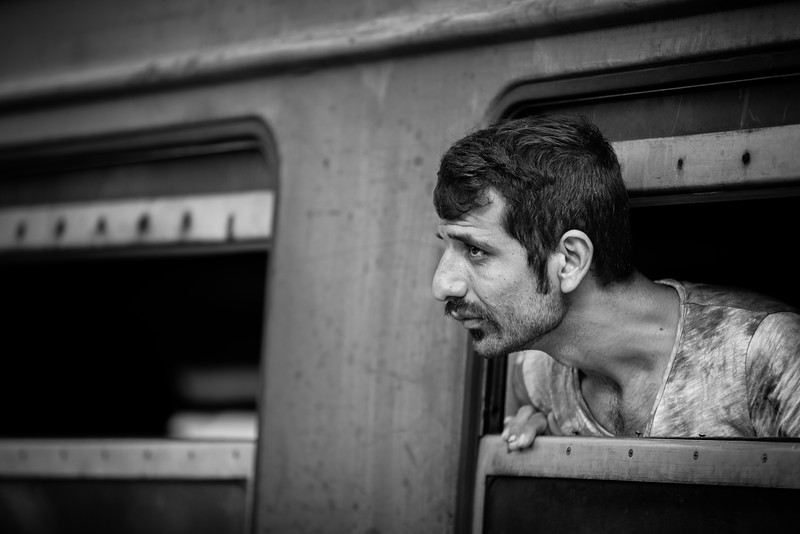 A man looks outside the train as he arrives at the end of the trip from the south of the country. Tabanovce, Macedonia (FYROM).