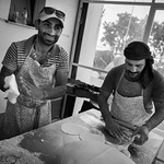 Syrian bakers at work in their improvised bakery in the temporary refugee camp of EKO petrol station. EKO camp, Polykastro, Greece. 2016. ---- Des boulangers syriens � l'oeuvre dans leur no ...