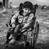 Young Syrian boy in a wheelchair near the refugee camp where he lives at the Syrian border.<br /> Beqaa Valley, Lebanon, 2015<br /> -----<br /> Jeune syrien en fauteuil roulant en retrait du camp de réfugiés où il demeure à la frontière Syrienne.<br /> Vallée de la Bekaa, Liban, 2015