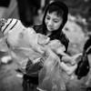 A boy protects his younger brother from the rain in Moria camp.<br /> Lesvos Island, Greece, 2015<br /> ----<br /> Un grand frère protège son plus jeune frère de la pluie à travers le camp de Moria.<br /> Ile de Lesbos, Grèce, 2015