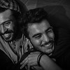 Syrian men chatting around a campfire during the night in the temporary refugee camp of EKO petrol station.<br /> EKO camp, Polykastro, Greece. 2016.<br /> ----<br /> Syriens discutant alentour d'un feu de camp dans leur camp de réfugiés de la station d'essence d'EKO.<br /> Polykastro, Grèce. 2016