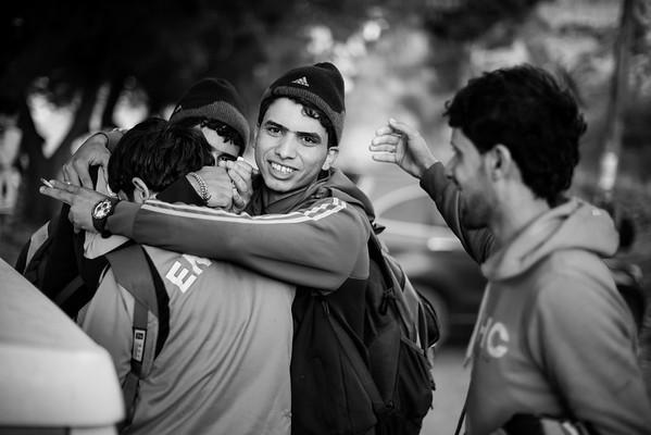 Group of young men celebrate as they got off the boat safely on the shores of Lesvos.<br /> Lesvos Island, Greece, 2015<br /> ----<br /> Groupe de jeunes hommes célébrant leur arrivée suite à la traversée en bateau s'étant bien passée.<br /> Ile de Lesbos, Grèce, 2015