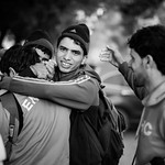 Group of young men celebrate as they got off the boat safely on the shores of Lesvos. Lesvos Island, Greece, 2015 ---- Groupe de jeunes hommes c�l�brant leur arriv�e suite � la travers� ...