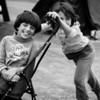 Two young friends playing around the temporary refugee camp in the port.<br /> Piraeus, port of Athens, Greece. 2016<br /> ----<br /> Deux jeunes amies jouent dans le camp temporaire du port.<br /> Le Pirée, port d'Athènes, Grèce. 2016
