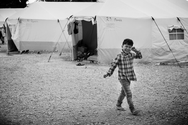 Afghan boy in front of his home in a permanent refugee camp.<br /> Oinofyta, Southern Greece. 2016<br /> ----<br /> Garçon afghan devant sa maison d'un camp de réfugiés permanent.<br /> Oinofyta, Sud de la Grèce. 2016