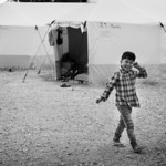 Afghan boy in front of his home in a permanent refugee camp. Oinofyta, Southern Greece. 2016 ---- Gar�on afghan devant sa maison d'un camp de r�fugi�s permanent. Oinofyta, Sud de la Gr�c ...