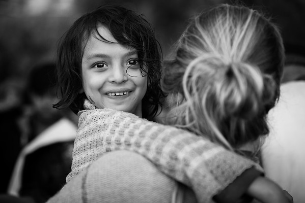 Syrian girl in the arms of volunteer, moments after getting off her inflatable boat.<br /> Lesvos Island, Greece, 2015<br /> ----<br /> Syrienne dans les bras d'une bénévole quelques instants après débarquée de son bateau gonflable.<br /> Ile de Lesbos, Grèce, 2015
