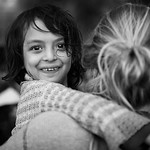 Syrian girl in the arms of volunteer, moments after getting off her inflatable boat. Lesvos Island, Greece, 2015 ---- Syrienne dans les bras d?une b�n�vole quelques instants apr�s d�ba ...