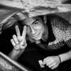 An Afghan man protects himself from the rain in his tent and offers his last cookie to the photographer.<br /> Lesvos Island, Greece, 2015<br /> ----<br /> Un homme afghan se protège du déluge sous sa tente et offre son dernier biscuit au photographe <br /> Ile de Lesbos, Grèce, 2015