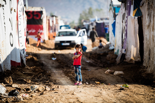 A little girl waits in an alleyway in a camp in the  Bekaa Valley, Lebanon.