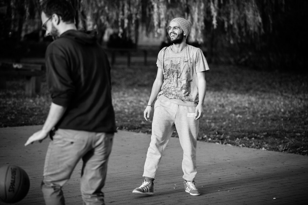 Salim playing basketball in the park with one fellow refugee and four local Germans. Sport is a universal language that anyone can speak. The integration of refugees in this little town is going splendidly. Eberswalde, Germany.