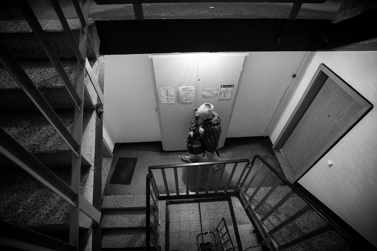 A man walks down the stairs of an apartment building partially reserved for refugees. Long term accommodation is assigned when there is enough availability. Eberswalde, Germany.