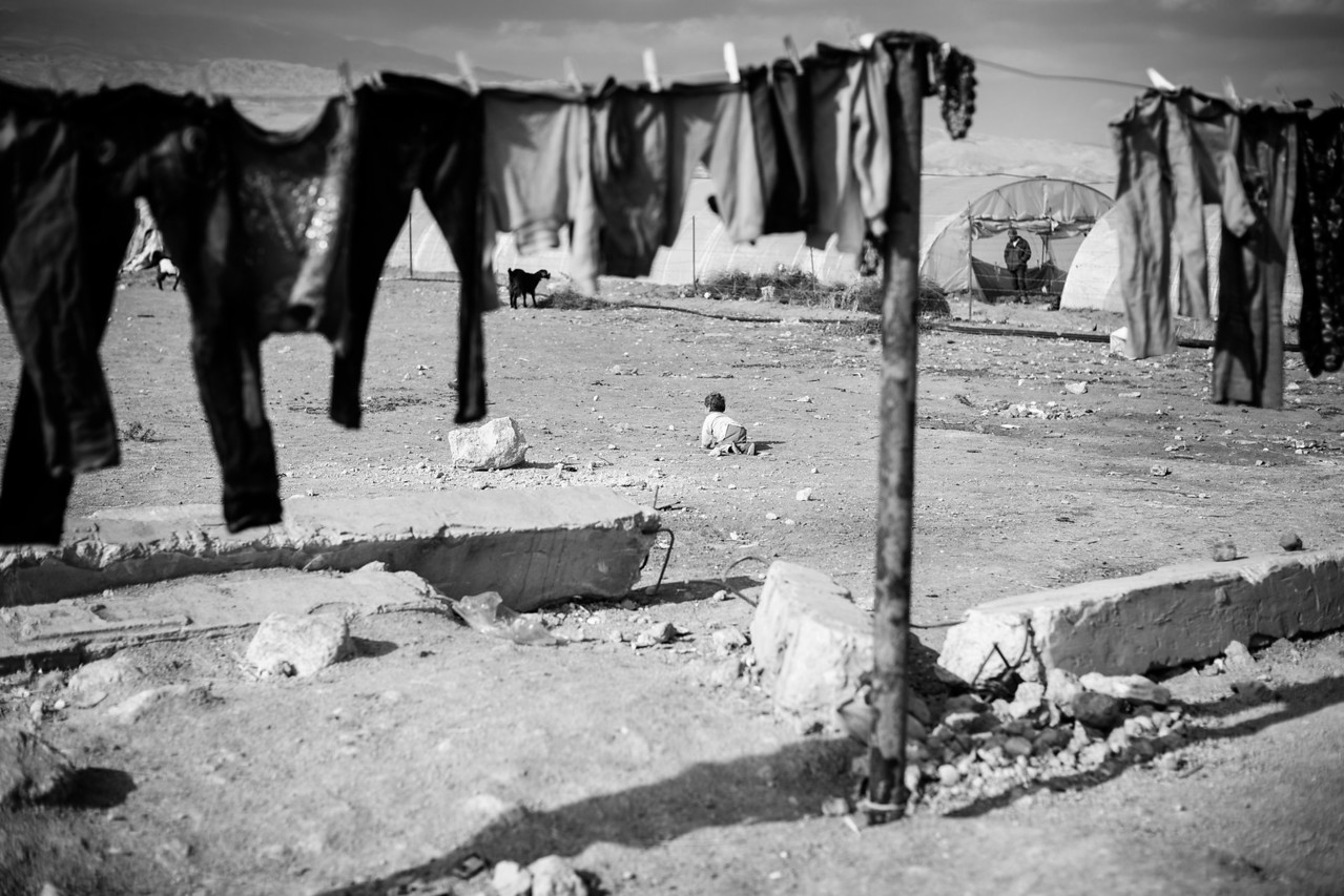 A child wanders around the camp in the Bekaa Valley, Lebanon.