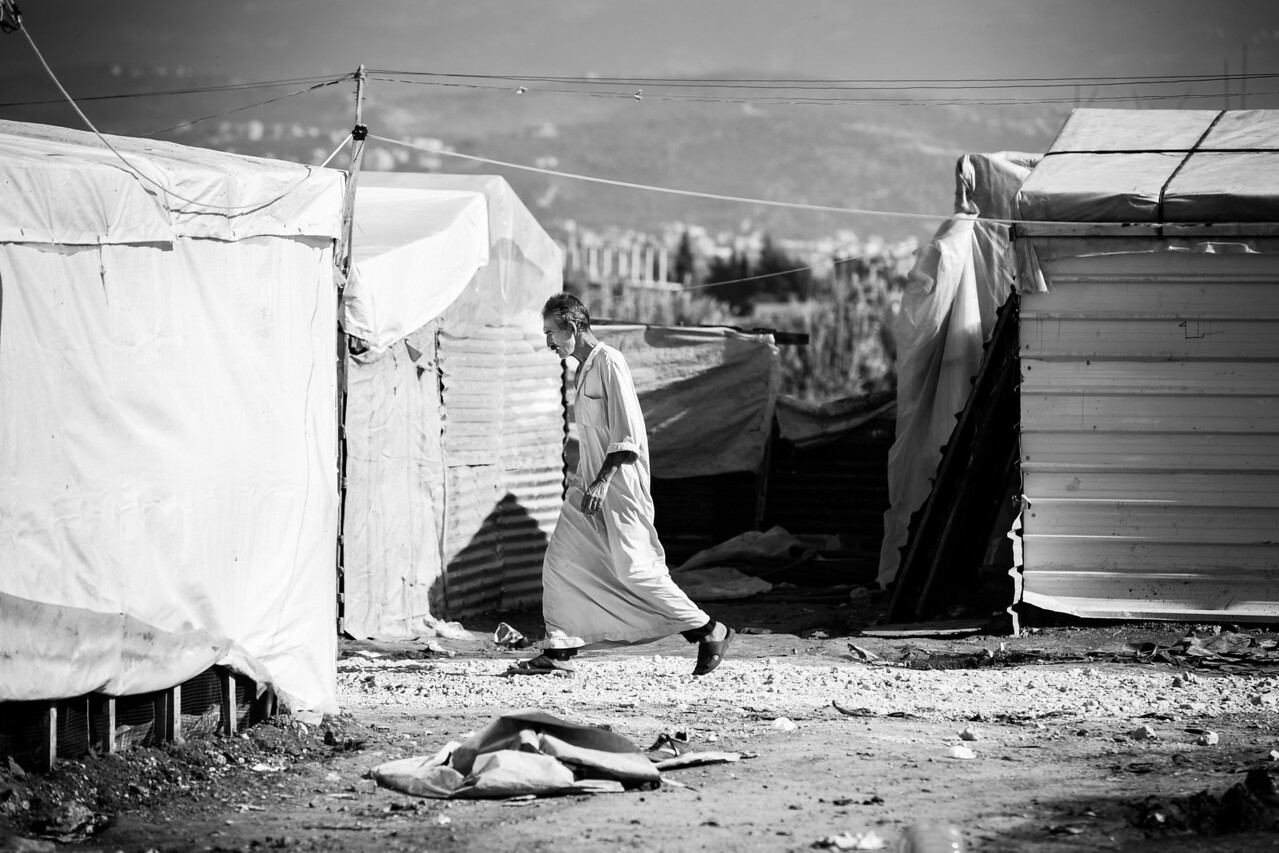 A man walks in the alleys between the houses in the camp in the Akkar District, Lebanon. Politically, the situation is extremely complicated for the refugees. The Lebanese Government does not recognize their status of refugees or even the existence of camps. Instead, they must pay a rent to occupy the land.