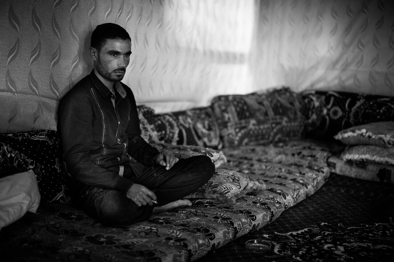 A man mourns the death of his uncle in Syria, a few kilometers away on the other side of the border. Many of the refugees living in the long term camps have relatives on the other side who are still facing danger. Bekaa Valley, Lebanon.