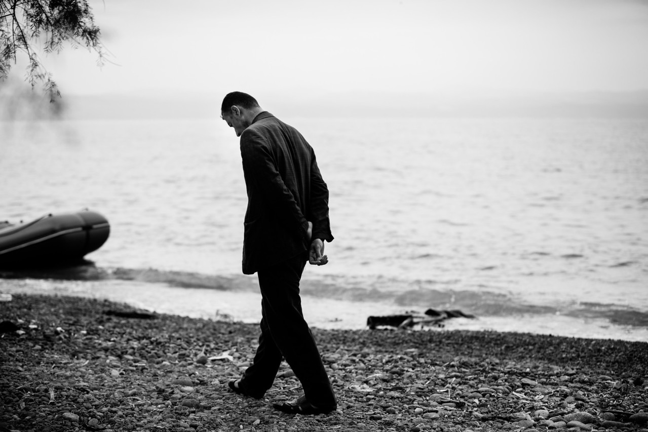 Another casualty from the dangerous Aegean Sea is mourned by this man. The sea takes many lives and is dangerous for everyone regardless of their age. Skala Sikamineas, Lesvos Island, Greece.