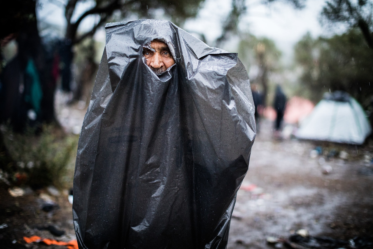 In the harsh weather conditions at Moria, anything can be used to protect from the rain. No shelter or better alternative is provided and the old are particularly vulnerable to diseases. Moria Camp, Lesvos, Greece.