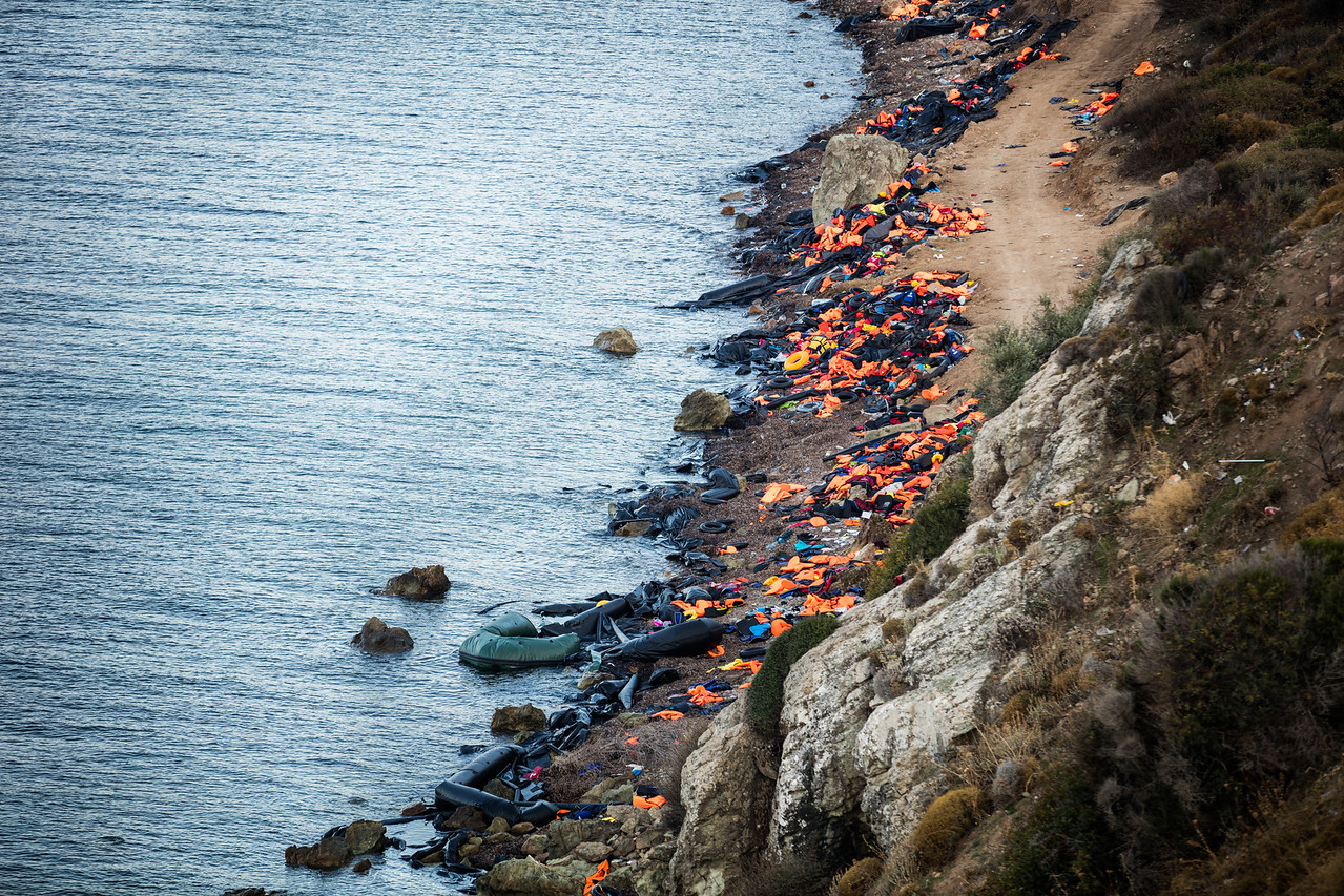 An impressive amount of trash from the arriving boats cover the beaches of Lesvos island. The view from the top of the cliffs gives a sense of proportions. Lesvos, Greece.
