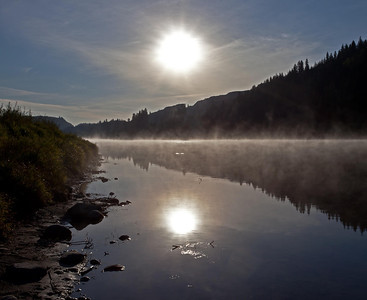 A misty morning sunrise on the Red Deer River as it flows through Dry Island Buffalo Jump Provincial Park.