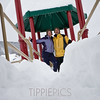 Day 275<br /> Rainbow Park<br /> <br /> A bit more snow than before, eh? That's me and my brother, Doug, playing on the playground just before going sledding! Wish we'd had more time, but we had a parade to go see with the family. LOL! (He and his family stayed with us for 5 days - we had a blast!)