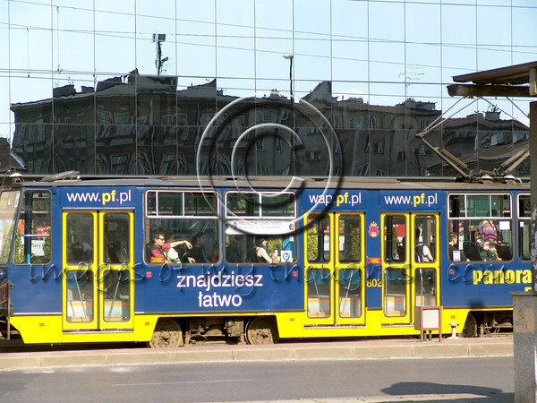The old Jewish houses in the ghetto are today reflected in the glass tower built across the street from the transshipment square and the tram runs underneath just as it did under Nazi occupation.  <b>Click on photo to enlarge</b>