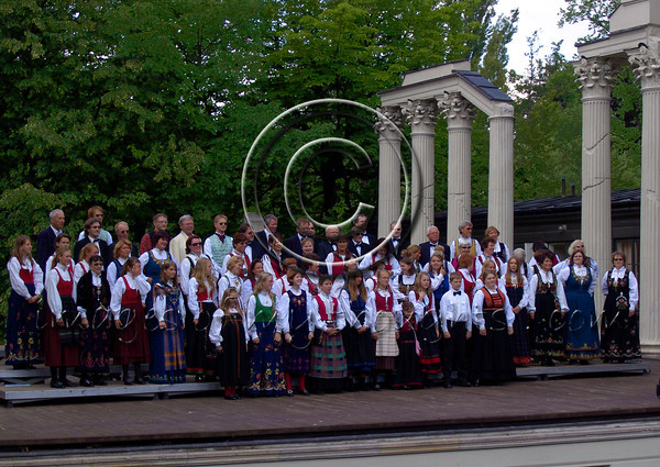 In an anciently designed amphitheater a Norwegian choir sings while peacocks scream in the background.              <b>Click on photo to enlarge</b>